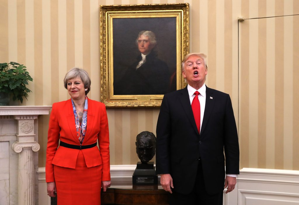 WASHINGTON, DC - JANUARY 27: British Prime Minister Theresa May looks on as U.S. President Donald Trump speaks in The Oval Office at The White House on January 27, 2017 in Washington, DC. British Prime Minister Theresa May is on a two-day visit to the United States and will be the first world leader to meet with President Donald Trump. (Photo by Christopher Furlong/Getty Images)